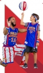 Win 1 of 12 Harlem Globetrotters Courtside Basketball Experiences for 4 People (various venues)
